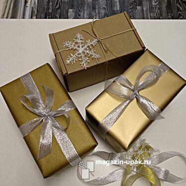 Упаковать подарок в золотую бумагу и коробки крафт